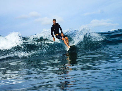 Founder of Kura Kura Surf Camp Lombok surfing a wave