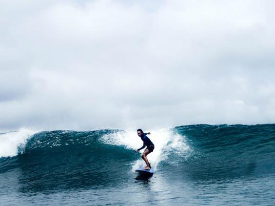 Intermediate surfer on a secret wave