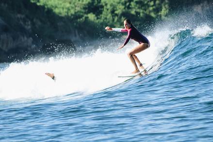 Annie on a wave in Ekas Insides