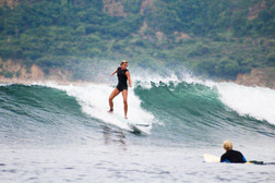 Gudi catching a wave at the famous Gerupuk Insides