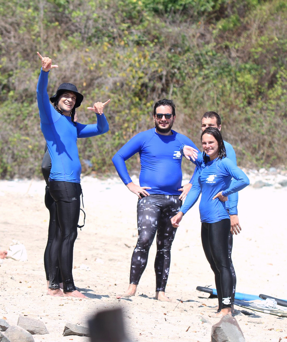 Group of guests from Kura Kura Surf Camp in rash guards