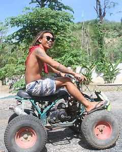 Indonesian guy sitting on an ATV buggy