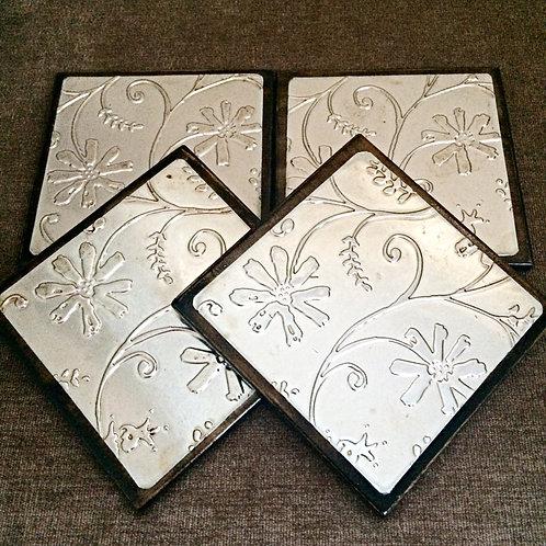 """Set of Four """"Flower"""" Metal Embossed Coasters"""