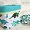 Panier et lingette dinosaure, coton bio, bleu, vert, blanc, Une touche de magie, Boutique Les créateurs de saison, Paris