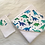 Cape de bain motif dinosaure, coton bio, bleu, vert, blanc, Une touche de magie, Boutique Les créateurs de saison, Paris