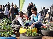 blacks planting food in a garden.jpg