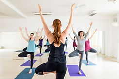female-instructor-with-yoga-class-in-the