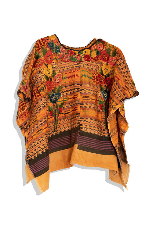 embroidered tunic with face