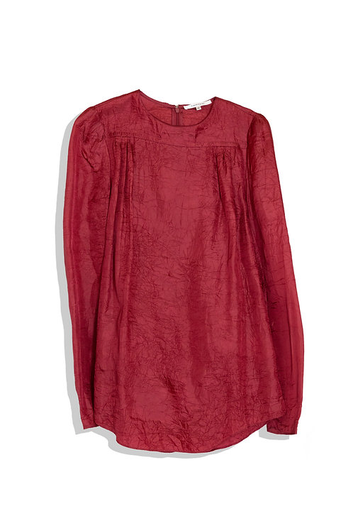 rouge blouse with tiny wrinkle