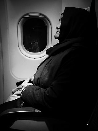 Woman in plane © Sabri Benalycherif