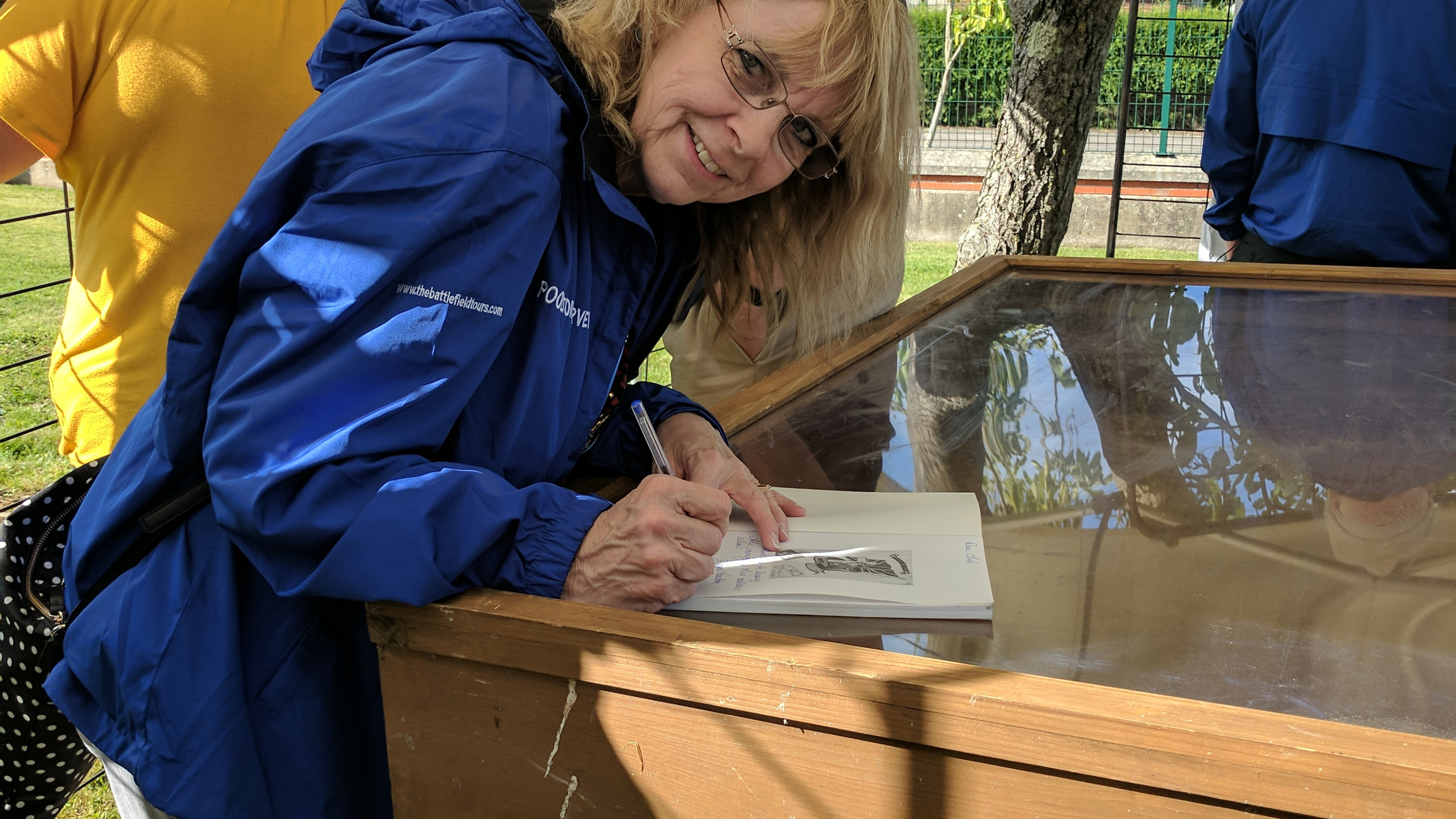 """Working with Jayne Poolton-Turvey, (co-author to her father's book """"Destined to Survive"""") was an absolute highlight for me this year. Here she is signing the book during the Dieppe 75 Tour for the community of  Saint-Nicolas-d'Aliermont.   For more information, visit: www.everymanremembered.com"""