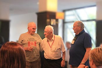 WW2 Veterans Bud Weeks & H Rowden discussing events at our group dinner in Normandy, 2014