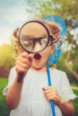 Girl with Magnifying glass.jpg