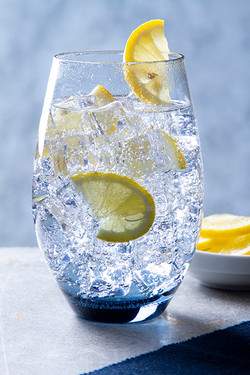 gin and tonic in blue glass by food photographer neil langan
