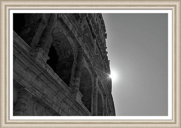 Sunrays over the Colosseum