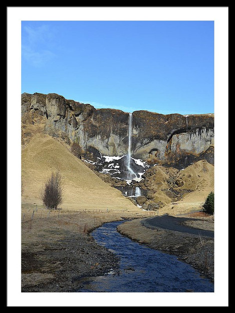 stream-leading-from-a-tall-waterfall-in-