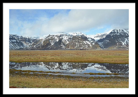 mountains-reflected-in-smooth-pond-water