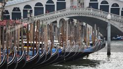 Gondolas below Rialto Bridge Venice