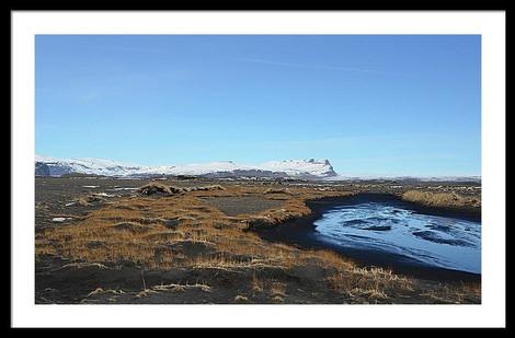 grass-and-stream-over-black-lava-field-u
