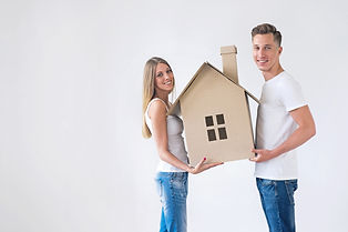 Young couple with the house of cardboard