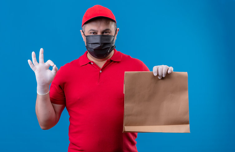 delivery-man-wearing-red-uniform-and-cap