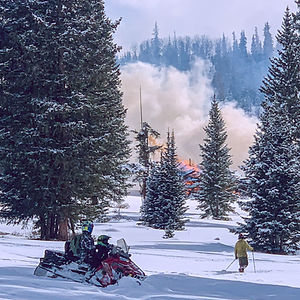 U.S. Forest Service burnign logging slash piles on the willow park trail on the Alpine Plateau in the Colorado Mountains