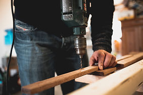 man-holding-wooden-stick-while-drilling-