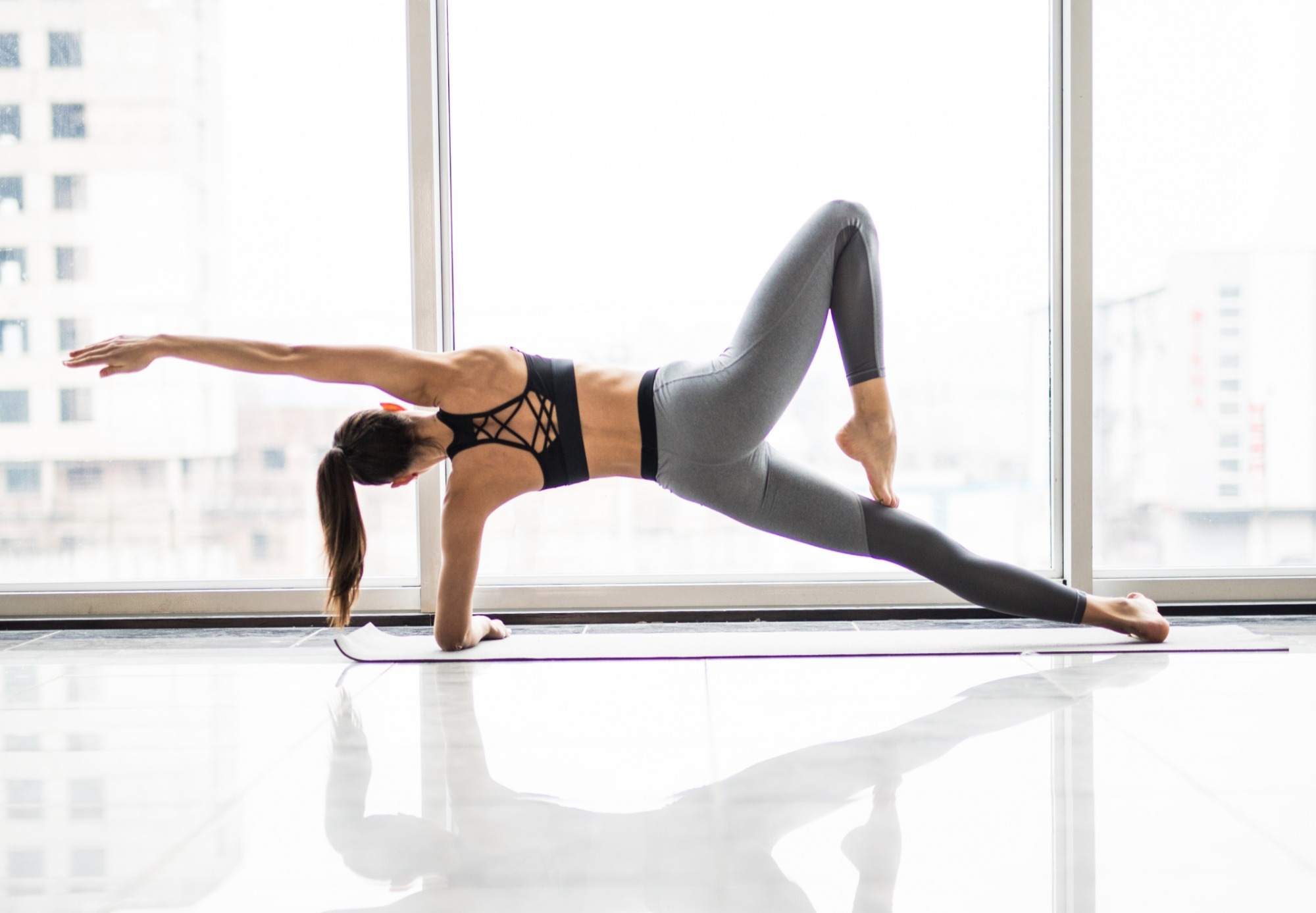 Young beautiful woman practicing yoga in