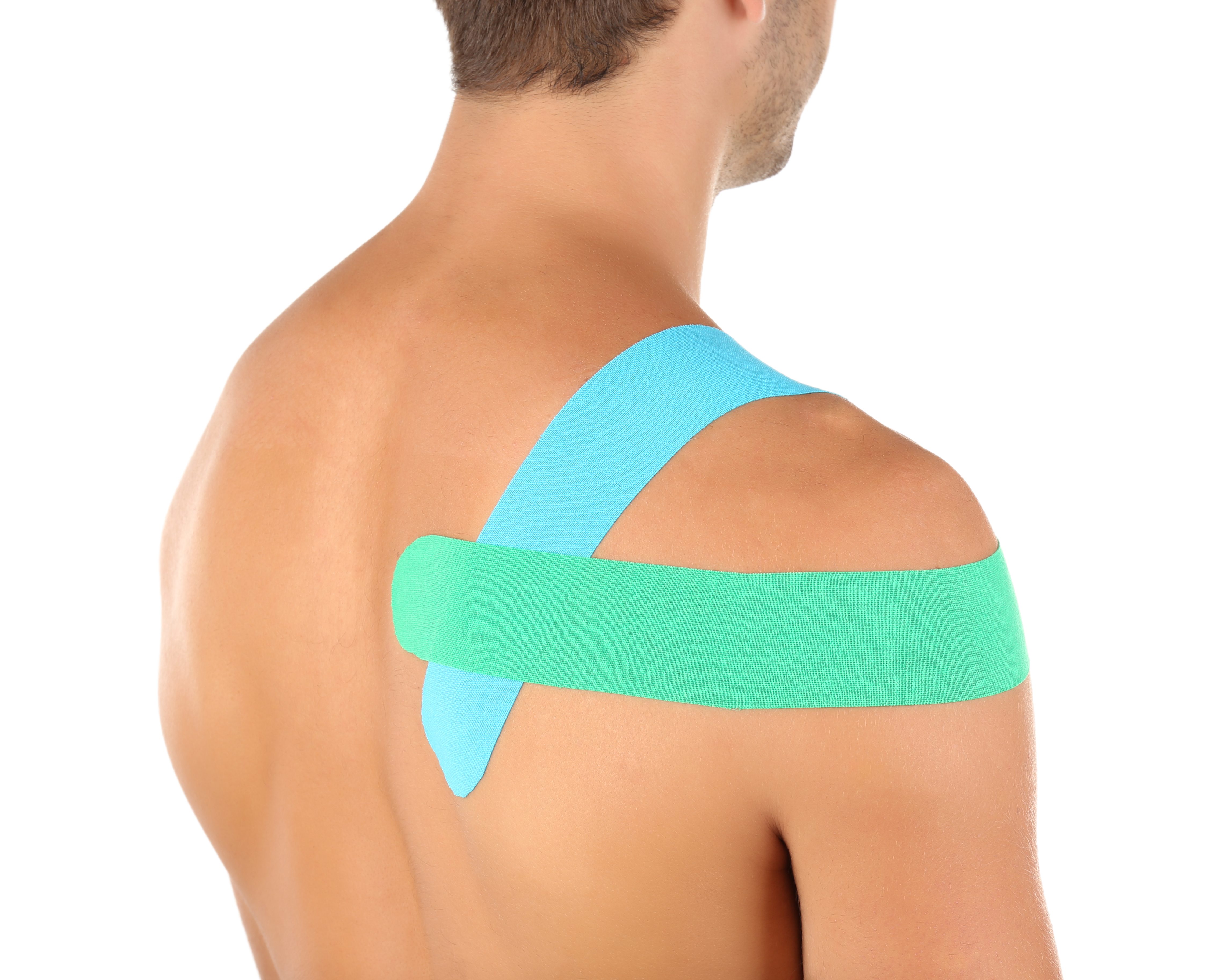 Physio tape on shoulder of sporty man is