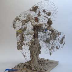63cm x 56cm x 58cm  Clay, chicken wire, wood, latex glove, sponge and tape  2020  Golwg o'r chwith / Left side view