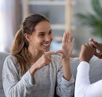 Two people communicating through sign language