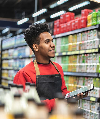 Person working in a store and using technology