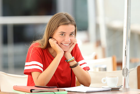 Happy Student Posing In A Coffee Shop.jp