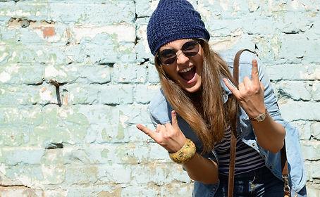 portrait of beautiful cool girl gesturin