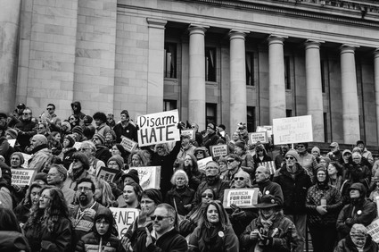 People protest the nationwide increase in school shootings and Trump's proposal to arm teachers at the National March for Our Lives at the Washington State Capitol Building.  Olympia, Washington March 2018