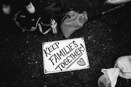 """A sign protesting the separation of migrant families at the People's Tribunal at the Northwest Detention Center. The living conditions of children taken into government custody has recently been exposed and the entire United States is up in arms about it. The Trump Administration has issued an executive order to reunite families, but lawyers are already having difficulties locating children that have been placed in the foster care system since the """"border crack-down"""" began. Countless families have already been torn apart forever. Furthermore, private prison corporations (the majority of which gave substantial financial support to the Trump campaign in 2016) are directly profiting from each person incarcerated in their prisons.  Tacoma, Washington February 2018"""
