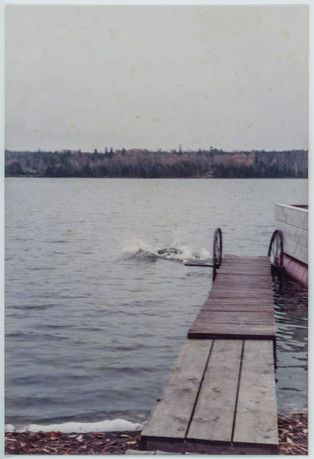 The first thing you do when you arrive back home at the lake: dive in. Brimson, Minnesota, c. 1965