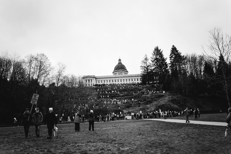 Women's March participants walk to Heritage Park from the Capitol Building.