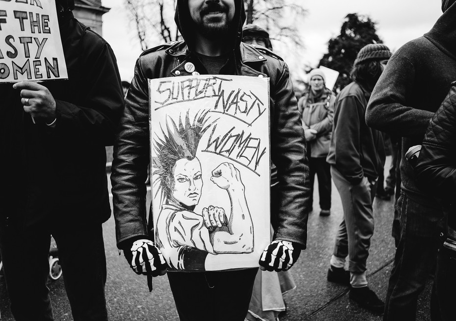 A young man makes an artistic connection to Rosie the Rivether at the Women's March.
