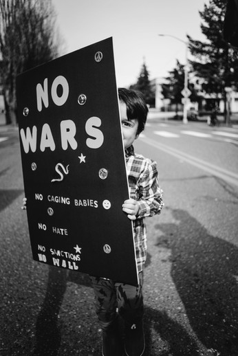 No Wars. No Sanctions. No Wall.