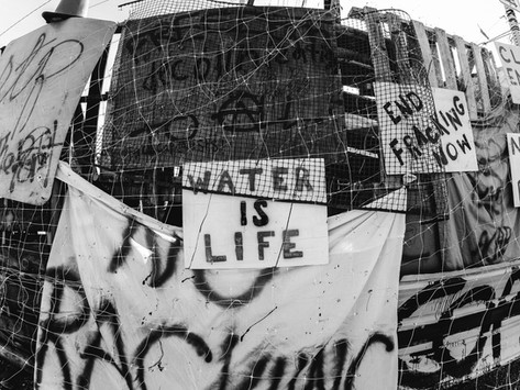 A sign on the pallet wall of the anti-fracking railroad blockade in downtown Olympia, Washington. A few days before Thanksgiving, activists blocked a train hauling fracking sands from entering the Port of Olympia. The blockade held for approximately a week, until a heavily armed SWAT team of police violently dispersed the water protectors at 4am on November 28th.  Olympia, Washington November 2017