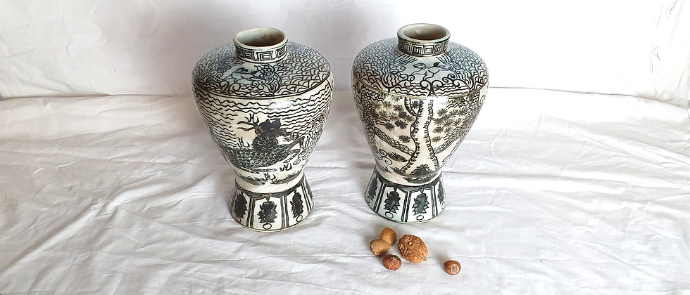 Pair of early 20th Century Black and White Oriental Vases