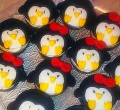 """Black Tie Baby Sitting"" logo themed cupcakes"