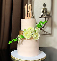 Pale pink 18th birthday tiered cake.JPG