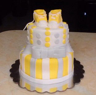 TIERED CAKE with baby booties