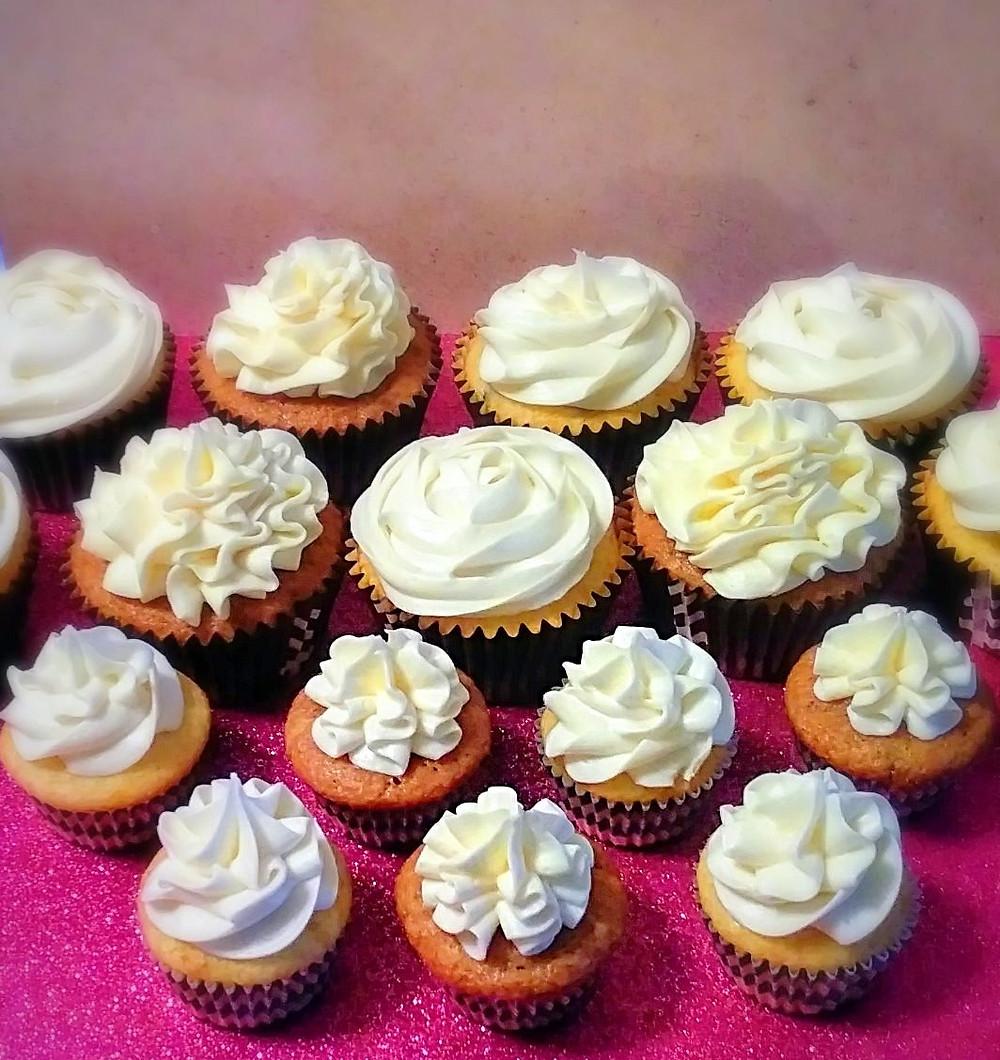 Regular and mini vanilla bittercream and brown sugar spice cupcakes