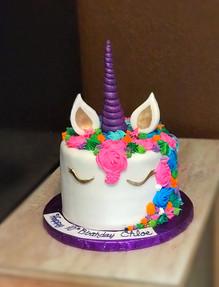 Rainbow Themed Unicorn with purple horn