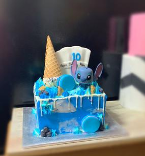Stitch square drip cake w.cone.JPG