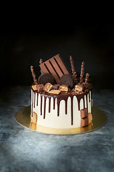 chocolate drip cake. with chocolate cand