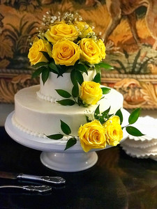 Tradtional Tiered Wedding Cake with yellow roses and babies breath